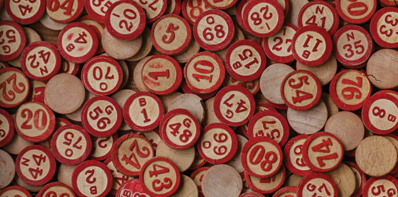 Many Bingo Numbers Laying On a Table
